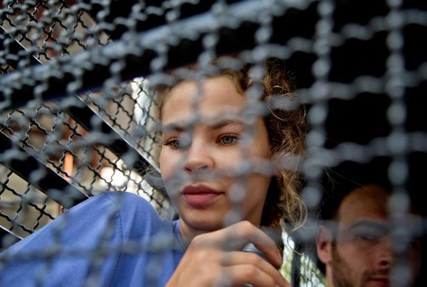anastasia-vashukevich-sits-in-a-police-transport-vehicle-outside-a-detention-center-in-pattaya-south_769694_